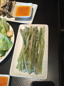 Fried crispy asparagus with sprinkled sichuan pepper